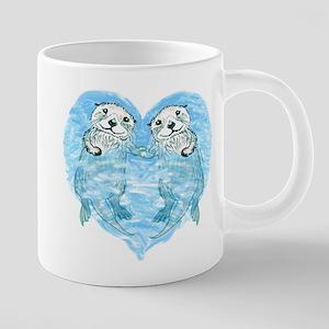 sea otters holding hands Mugs