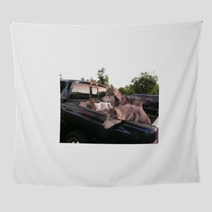 Siberian huskies in a green Dodge pi Wall Tapestry