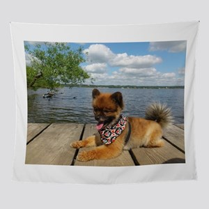 pomerainian puppy on dock Wall Tapestry