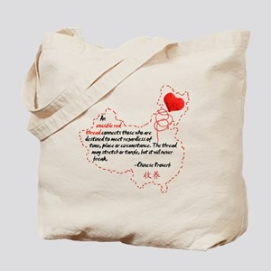 Red Thread on Light Tote Bag