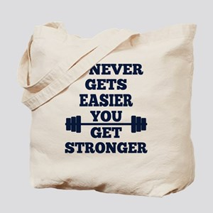It Never Gets Easier You Get Stronger Tote Bag