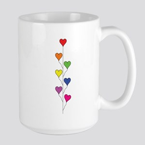 Seven Rainbow Colored Heart Balloons - Vertical Mu
