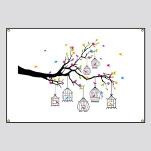 tree branch with birds and birdcages Banner