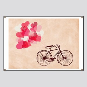 Heart-Shaped Balloons and Bicycle Banner