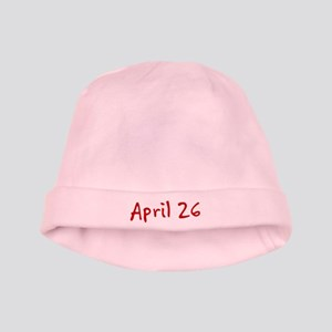 """April 26"" printed on a baby hat"