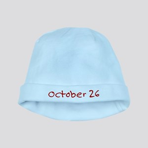"""October 26"" printed on a baby hat"