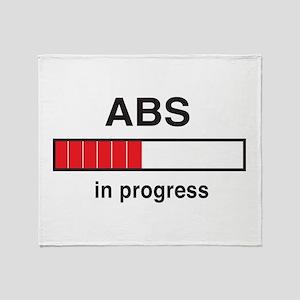 Abs in progress Throw Blanket