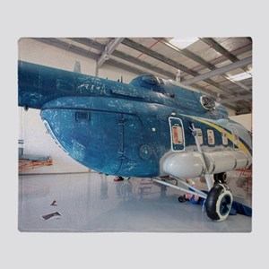 Helicopter in servicing hangar Throw Blanket