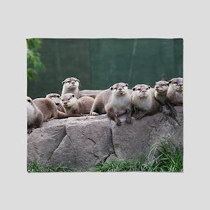 Otter family Throw Blanket