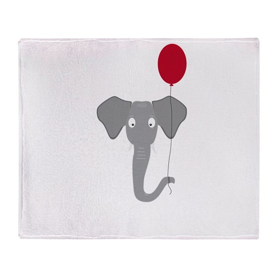 Elephant head with red balloon