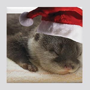 A Cute Sleepy Otter wearing a Santa C Tile Coaster