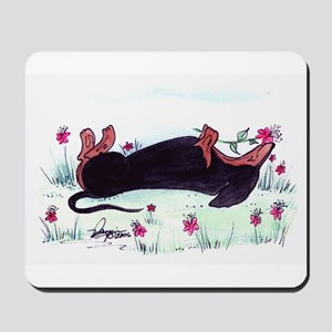 Dachshund enjoying flowers Mousepad