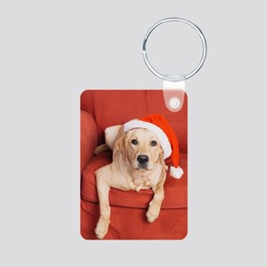 Dog with Christmas hat on armchair Keychains