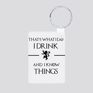 I drink and I know things Keychains