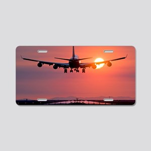 Aeroplane landing at sunset Aluminum License Plate