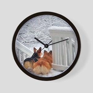Two Corgis in winter snow Wall Clock