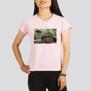 Old log cabin in woods, Al Performance Dry T-Shirt