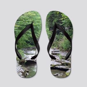 forest river scenery Flip Flops