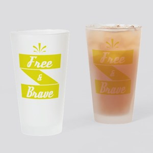 """Free and Brave"" tee desi Drinking Glass"