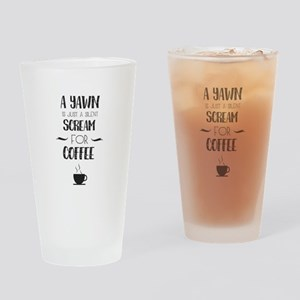 a yawn is a silet scream for coffee Drinking Glass
