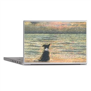 A Border Collie dog says hello to the Laptop Skins