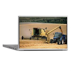 Combine harvester off-loading grain Laptop Skins