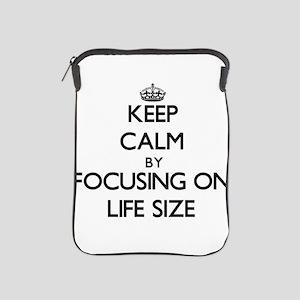 Keep Calm by focusing on Life Size iPad Sleeve