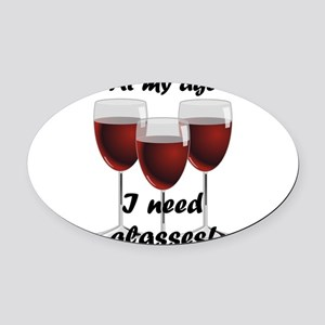 At my age I need glasses! Oval Car Magnet