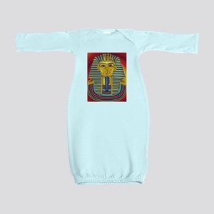 Tut Mask on Red Baby Gown