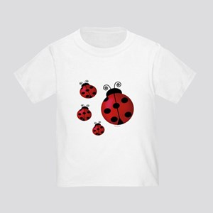 Four ladybugs Toddler T-Shirt