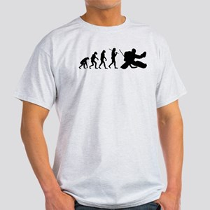 The Evolution Of The Hockey Goalie Light T-Shirt