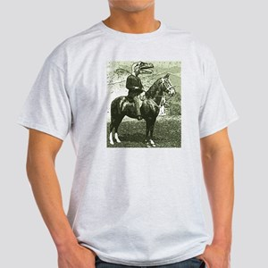 dinosaur man on horse T-Shirt