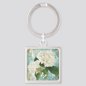 White hydrangea on blue Keychains