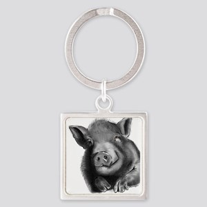 Lucy the wonder pig Keychains