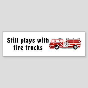 """Still plays with fire trucks"" Bumper Sticker"