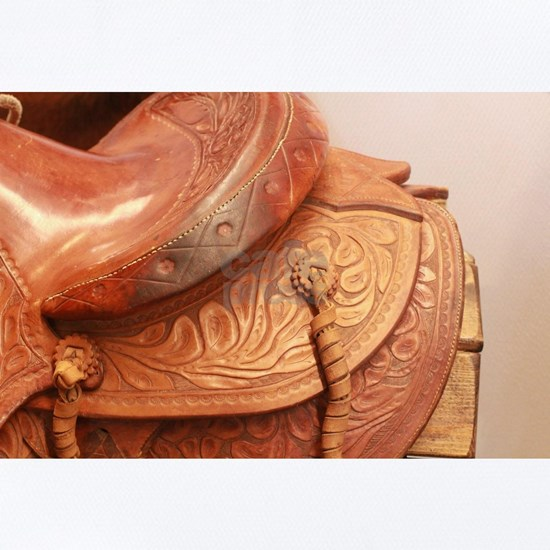 Tooled leather saddle close up showin detail