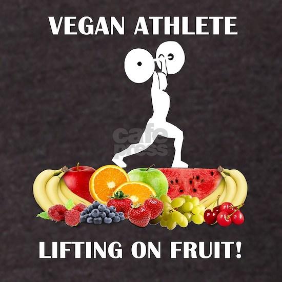 Vegan Athlete Lifting on Fruit