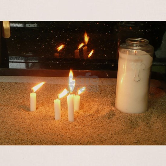 candles in sand at Assyrian Church of the East