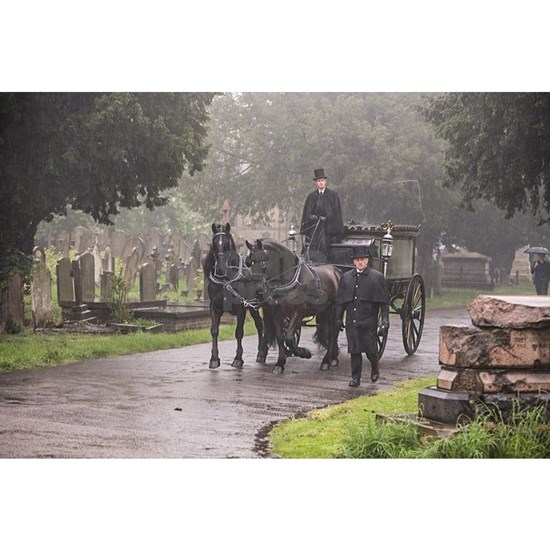 FUNERAL IN THE RAIN