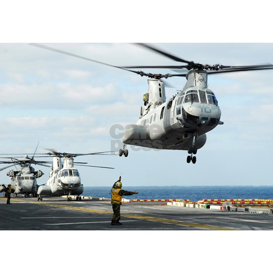 A CH-46E Sea Knight helicopter takes off from the