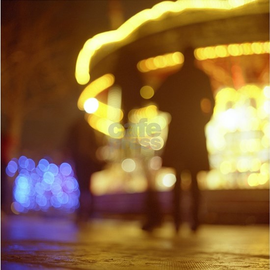 People walking in street at night with fairground