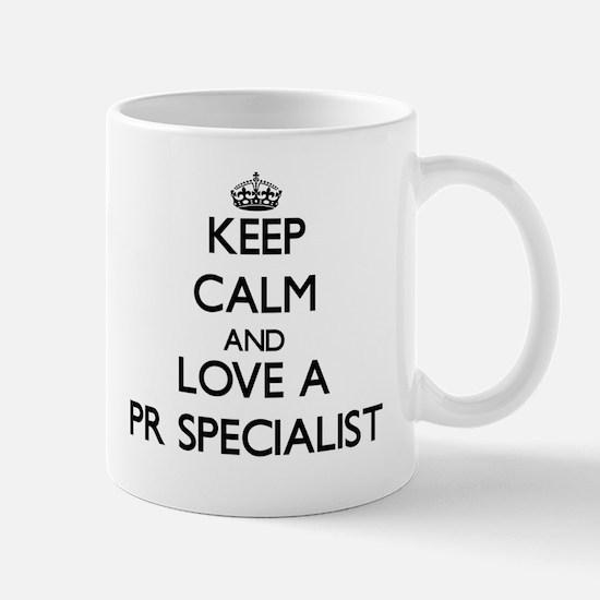 Keep Calm and Love a Pr Specialist Mugs