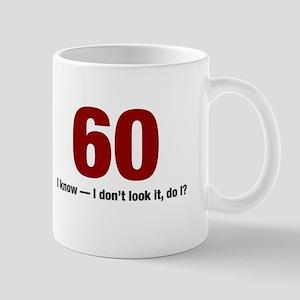 60 I dont look it do I Mugs