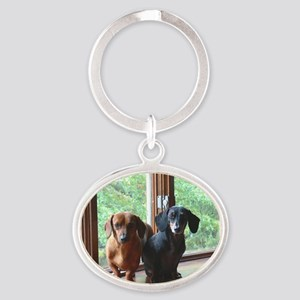 dasie and harley window seat Oval Keychain