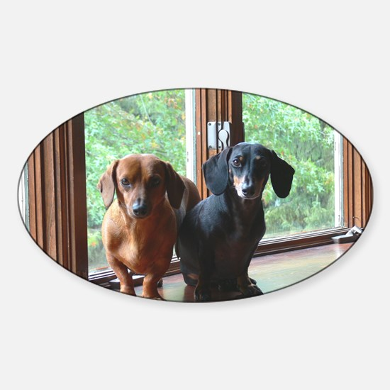 dasie and harley window seat Sticker (Oval)