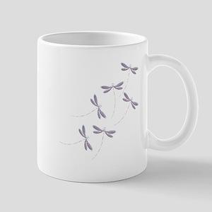 Dragonfly flight Mugs