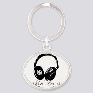 Rockin to a Different Tune Silver Oval Keychain