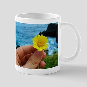 Holding a flower Mugs