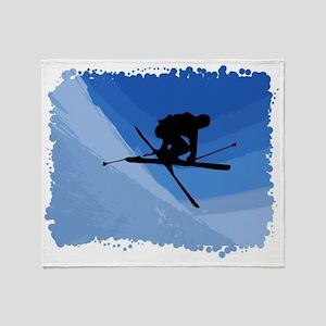 Skier jumping skis crossed Throw Blanket
