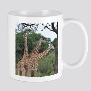 three giraffes Mugs
